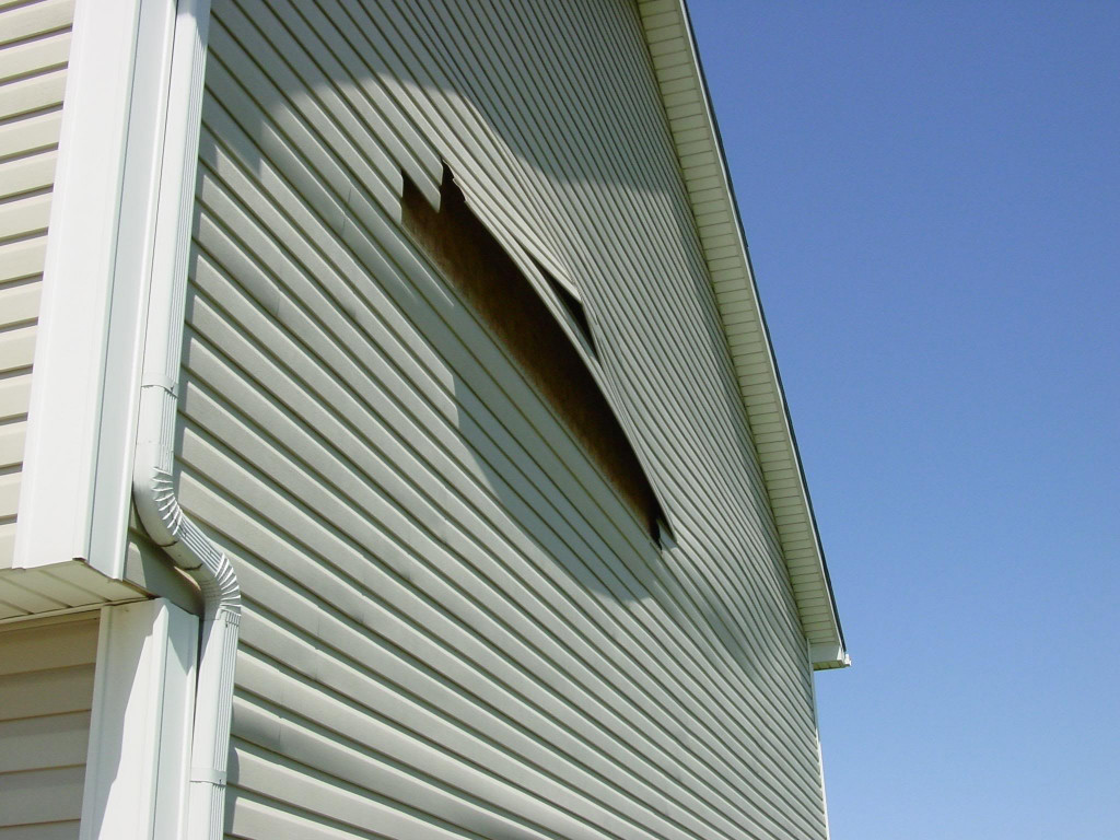 Storm damage carlson exteriors inc for Hail damage vinyl siding