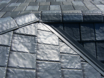 Metal shingles that resemble slate