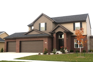black-roof-black-board-and-batten-shutters-certainteed-sable-brown-shakes-mastic-pebblestone-clay-siding-normal-il