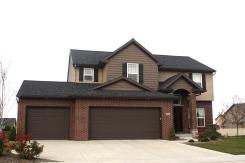 black-roof-certainteed-sable-brown-shakes-mastic-pebblestone-clay-siding-normal-il-blackstone