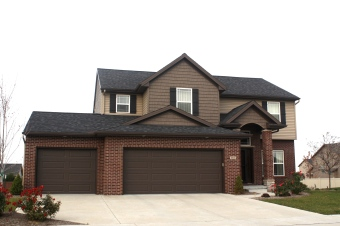 black-roof-certainteed-sable-brown-shakes-mastic-pebblestone-clay-siding-normal-il-blackstone