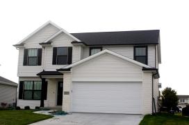 black-roof-white-trim-mastic-linen-light-cream-siding-black-gutters-bloomignton-il