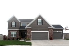 black-roof-white-trim-mastic-pebblestone-clay-siding-certainteed-sable-brown-shakes-normal-il-blackstone