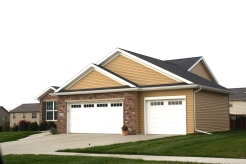 black-roof-white-trim-white-garage-door-certainteed-buckskin-tan-siding-normal-il-blackstone