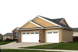 black-roof-white-trim-white-garage-door-certainteed-buckskin-tan-siding-normal-il-blackstone