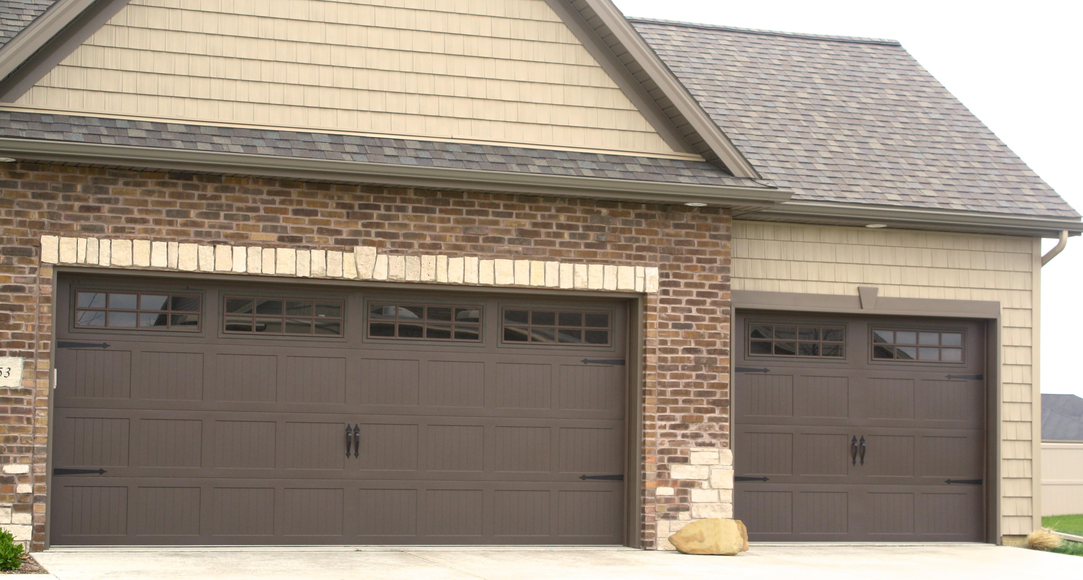brown garage doors with windows. Brown-carriage-style-garage-door-in-bloomginton-il-with-gridded-window -panes-and-keystone-casings-in-wexford-subdivision Brown Garage Doors With Windows