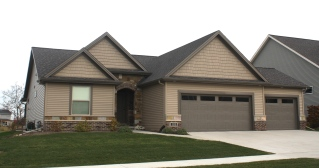 certainteed-landmark-dark-roof-in-driftwood-mastic-pebblestone-clay-siding-terra-bronze-trim-northwoods-faux-cedar-shakes-in-natural-clay-terra-bronze-carriage-style-garage-doors-normal-il-blacks