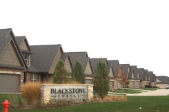certainteed-landmark-driftwood-dark-roof-exteria-handsplit-faux-cedar-shakes-dark-brown-trim-mastic-pebblestone-clay-siding-normal-il-blackstone