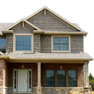 exteria-handsplit-shake-in-weathered-white-shake-corners-decorative-gable-accents-pebblestone-clay-trim-landmark-weatheredwood-shingles-bloomington-il-tipton-trails