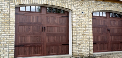 Faux wooden doors are not that much more than the same style in a solid color. Maintenance Free!
