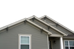 3 gables with decorative able accents, corbels and starburst