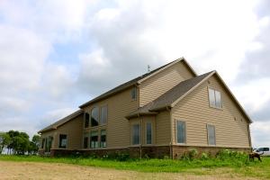 Tan hardboard siding with CertainTeed weathered wood roof