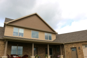 Weathered wood shingles, chestnut brown shakes, latte tan siding, tan gutters