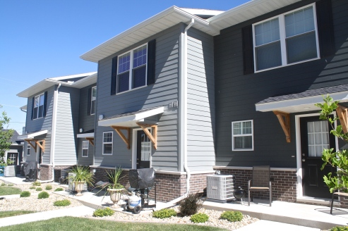two story town homes with two toned grey siding