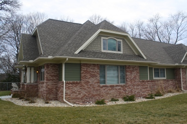 james-hardie-fiber-cement-siding-and-staggered-shake-in-custom-green-and-certainteed-landmark-weathered-wood-roof-in-normal-il