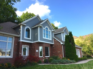 house with three gables all with blue fiber cement straight edged shake