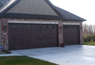 wooden garage doors in brick