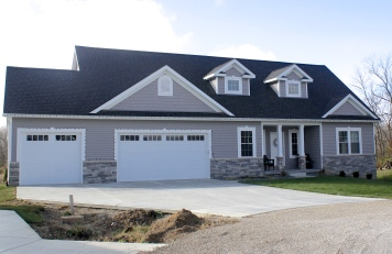 Short panel, white carriage style garage door with long panel madison windows in Downs il