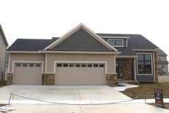 mastic-pebblestone-clay-siding-with-lighter-tan-corners-exteria-dual-staggered-faux-cedar-shake-dark-siding-normal-il-blackstone