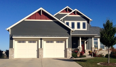 dark siding with red gable accents craftsman style home and stone