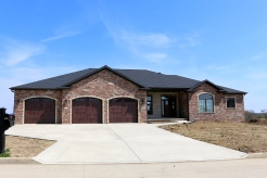 three single car garage wooden doors with arched windows