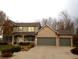 tan brick house with tan siding,