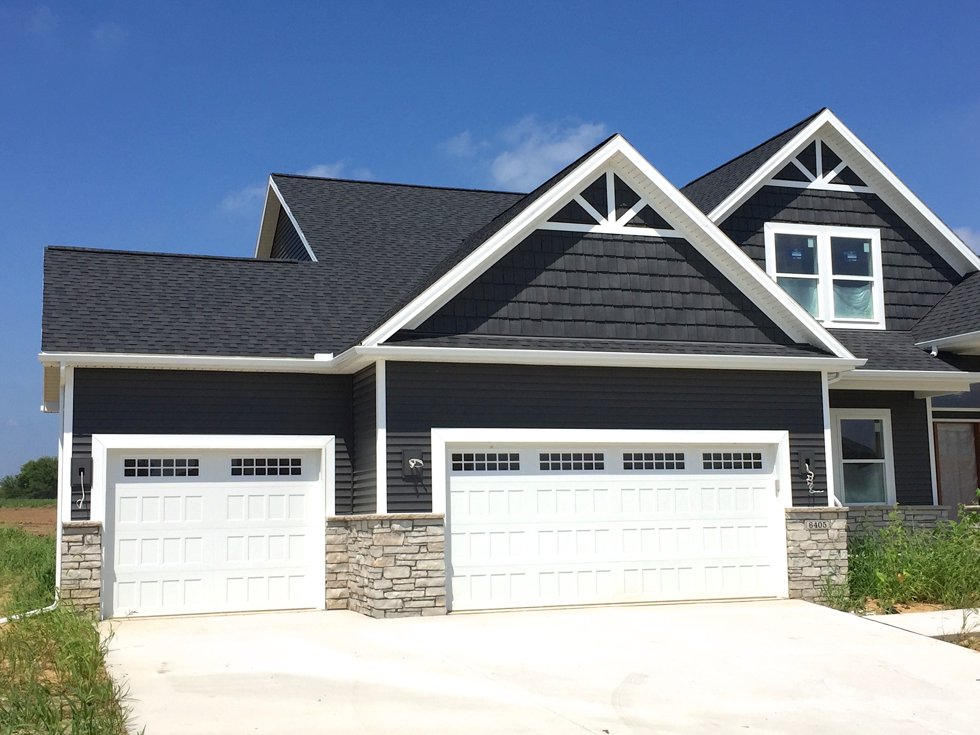Royal ironstone dark grey siding and dark grey shakes for Exterior house decorative accents