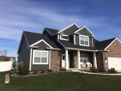 royal-ironstone-dark-grey-siding-and-dark-grey-shakes-white-trim-certainteed-landmark-weathered-wood-roofing-in-morton-il
