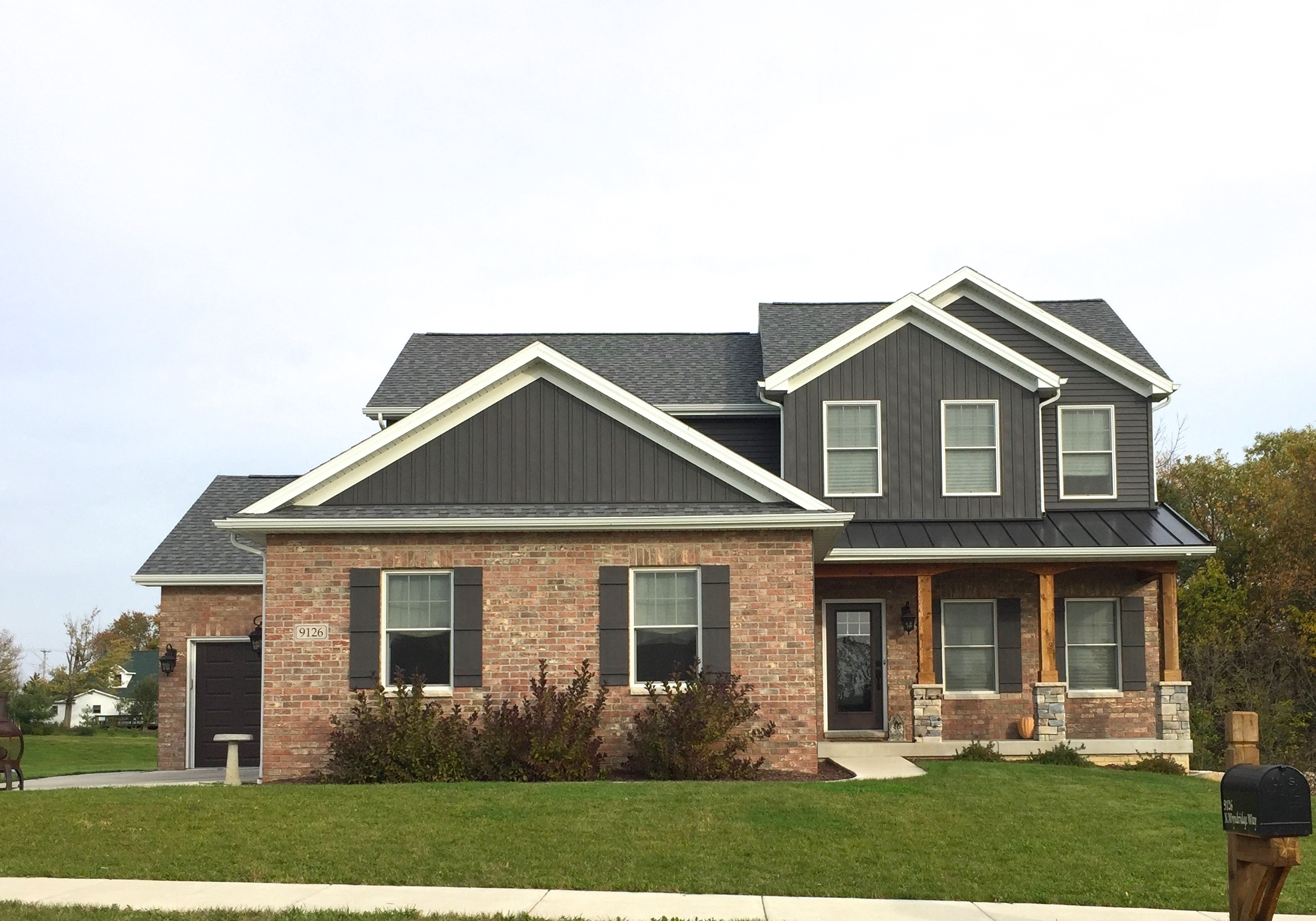 Royal vertical siding in ironstone dark grey white trim for Accent housing