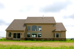 Weathered wood roof and tan siding in chatsworth il