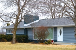 weatheredwood roof replacement in Morton IL with english wedgewood blue siding