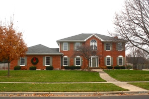 Red brick colonial home with new windows
