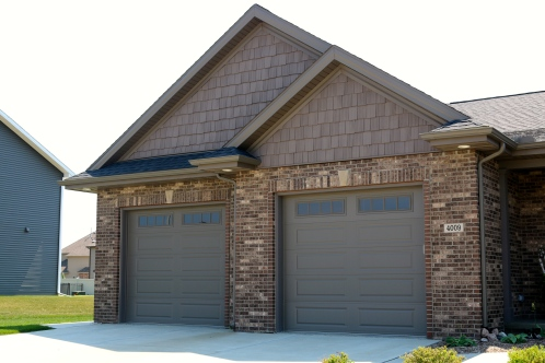 Bronze garage doors with long panels and mission window panels