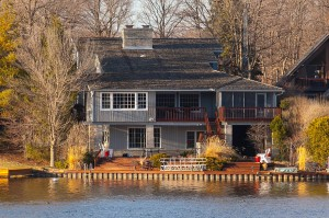 wooden roof on lake house grown over with algae growth