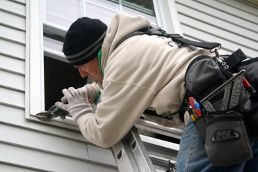 Man instilling window with great care