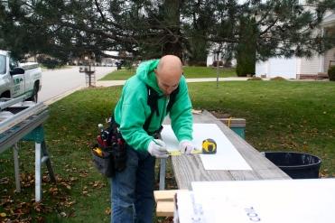 Foreman Brian Peavler gets ready for a custom window wraps