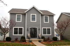 mastic-deep-granite-grey-siding-and-white-trim-re-side-and-thermatru-entry-door-replacement-in-normal-il