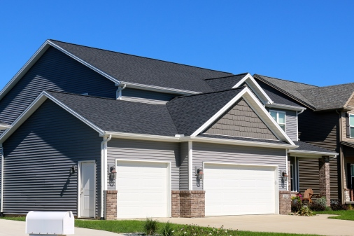 Mastic Deep Granite siding with Royal Weathered Grey hand split shakes, white trim, and moire black roof in Bloomington, Mastic Deep Granite siding with Royal Weathered Grey hand split shakes, white trim, and moire black roof in Bloomington, IL