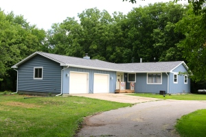 Blue vertical siding and blue shake add nice texture to this bloomington il home