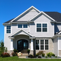 Mastic Silver Grey siding, Mastic Cedar Discovery handsplit shakes in silver grey, white trim and Morie black roof