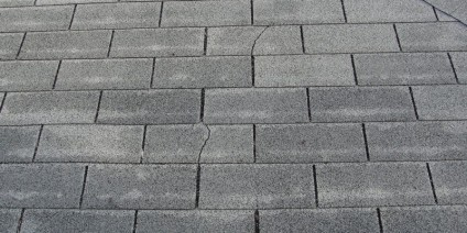 cracked asphalt shingles