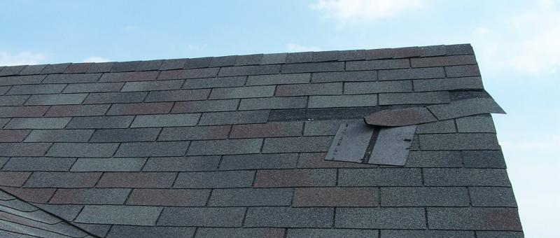 roof with loose shingles