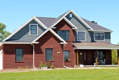 LP Smartside siding in Pewter with White trim and Black roof and Metal Roof accent