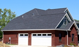 LP Smartside siding in Pewter with White trim and Black roof