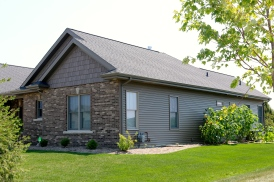 Montana suede dark brown shakes and siding and black roof in Bloomington IL