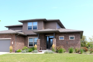 Montana suede dark brown siding with Terra Bronze trim Weathered wood roof in Bloomington IL