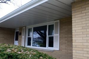 picture window in tan brick home