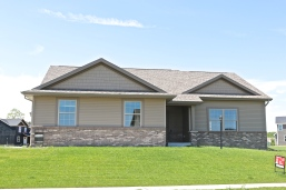 Mastic Rugged canyon siding and shakes with Terra Bronze trim coil and CertainTeed Landmarks in Weathered Wood