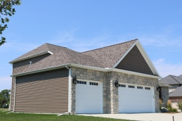 Montana Suede dark brown siding with White trim and Mission Brown roof color in Bloomington IL