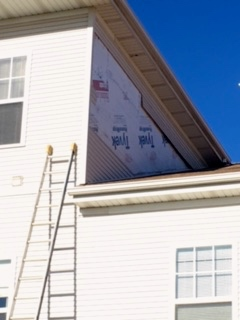Wind during a storm pulled of a large section of this home's siding